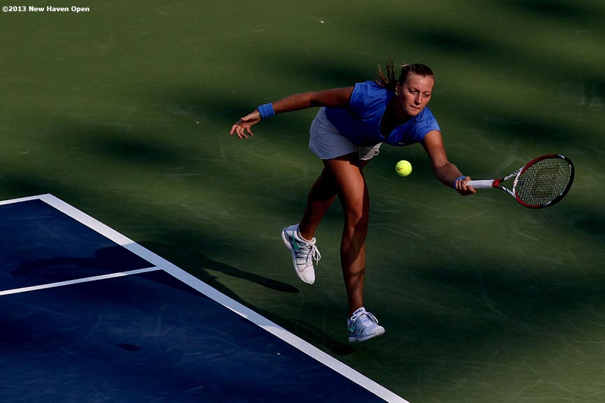 """Petra Kvitova lunges to return a serve on Day 5 of the New Haven Open at Yale University in New Haven, Connecticut Tuesday, August 20, 2013."""