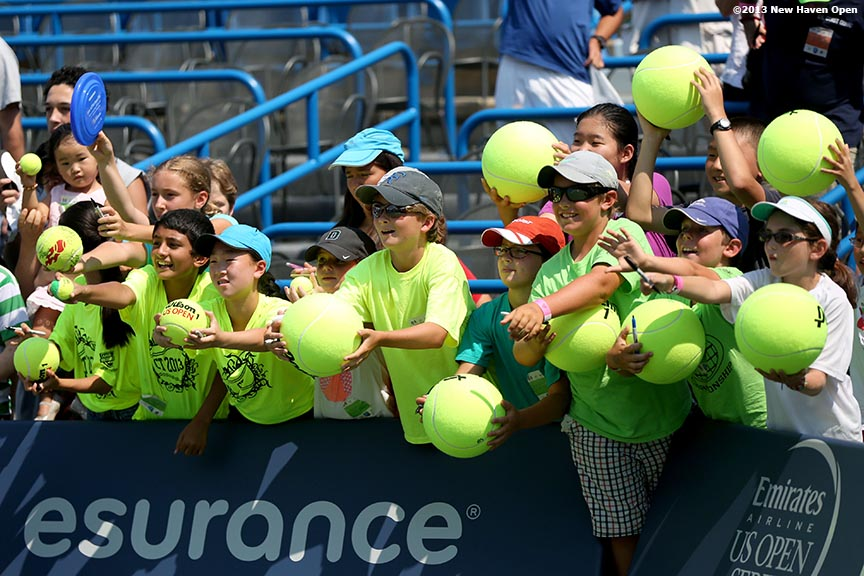 """Fans line up for autographs on Stadium Court following a match on Day 5 of the New Haven Open at Yale University in New Haven, Connecticut Tuesday, August 20, 2013."""