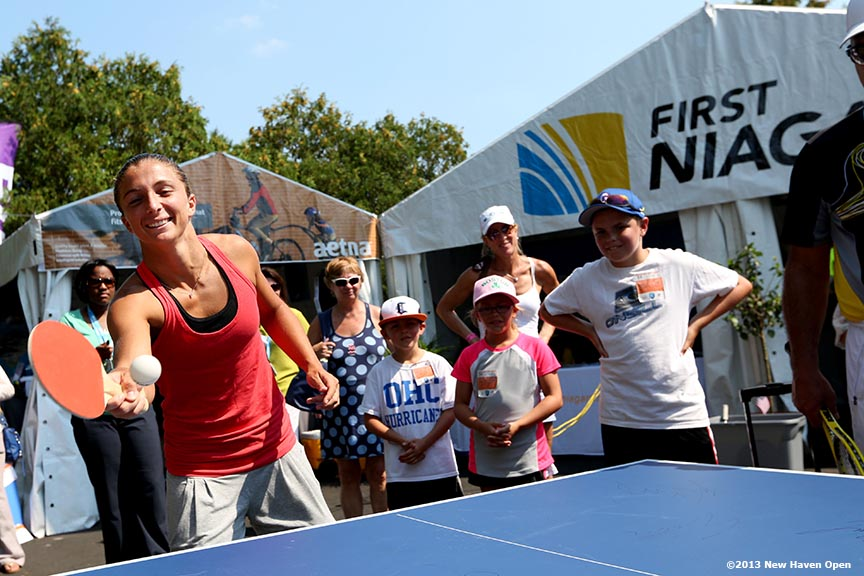 """Sara Errani plays a game of table tennis after an autograph session on Day 5 of the New Haven Open at Yale University in New Haven, Connecticut Tuesday, August 20, 2013."""