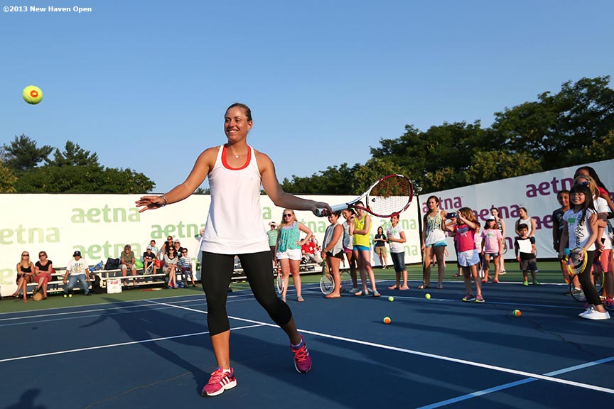 """Angelique Kerber hits a forehand during a demonstration at a 'Girl Scout Day' tennis clinic on Day 5 of the New Haven Open at Yale University in New Haven, Connecticut Tuesday, August 20, 2013."""