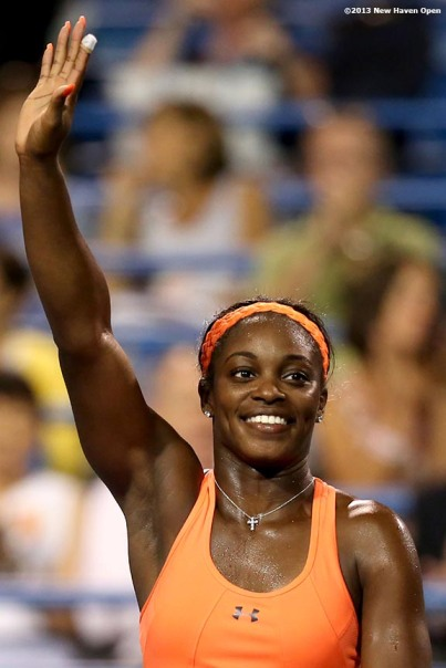 """Sloane Stephens waves to the crowd on Stadium Court after defeating Julia Goerges on Day 6 of the New Haven Open at Yale University in New Haven, Connecticut Wednesday, August 20, 2013."""