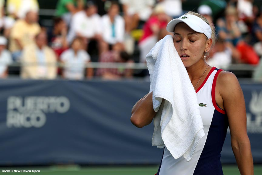 """Elena Vesnina wipes her face with a towel between points during a match on Day 7 of the New Haven Open at Yale University in New Haven, Connecticut Thursday, August 20, 2013."""