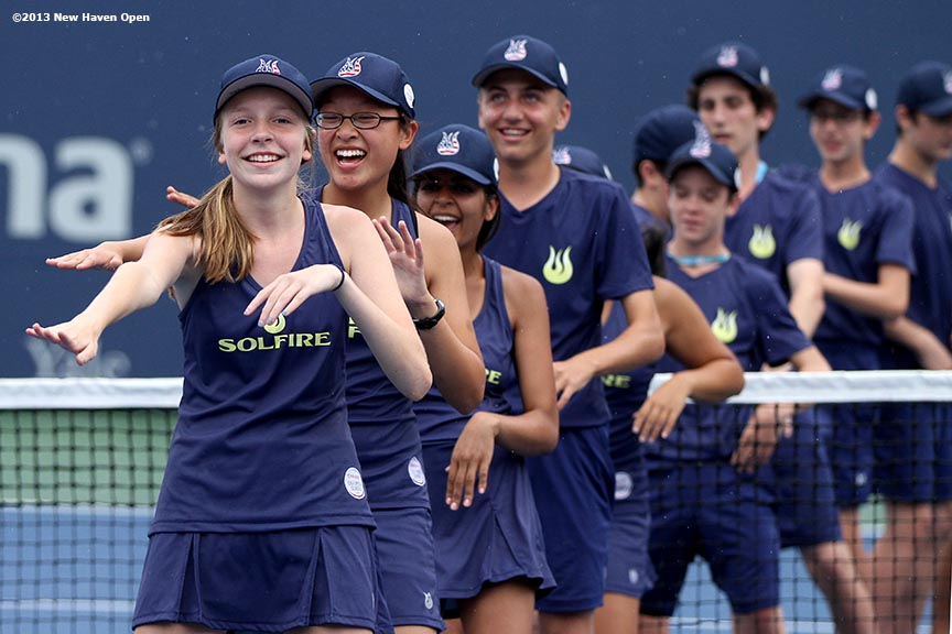 """""""Ball Kids dance on Stadium Court during a rain delay on Day 7 of the New Haven Open at Yale University in New Haven, Connecticut Thursday, August 20, 2013."""""""