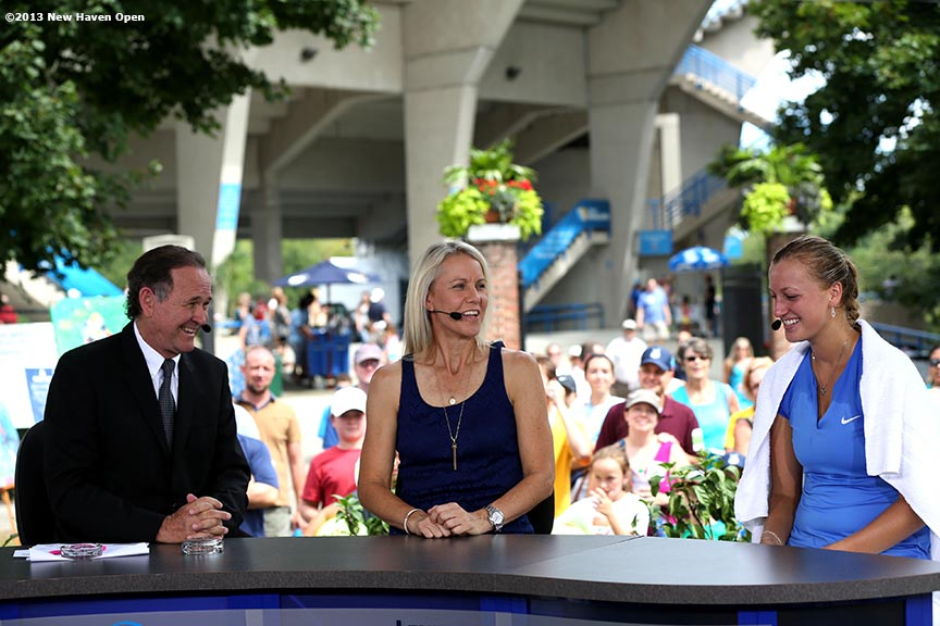 """Petra Kvitova (right) visits with anchors and Rennae Stubbs of ESPN on Day 8 of the New Haven Open at Yale University in New Haven, Connecticut Friday, August 20, 2013."""
