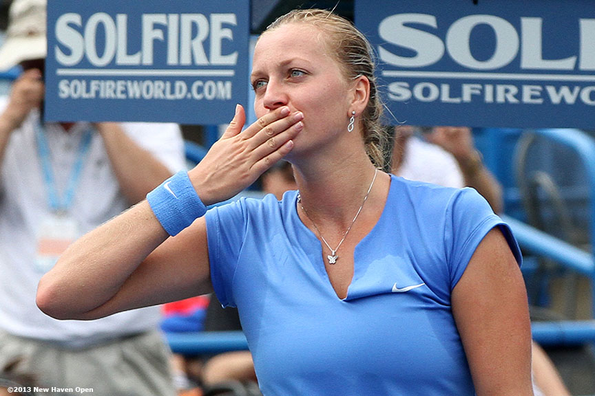 """Petra Kvitova blows a kiss as she acknowledges the crowd on Stadium Court after defeating Klara Zakopalova in the semi-finals on Day 8 of the New Haven Open at Yale University in New Haven, Connecticut Friday, August 20, 2013."""