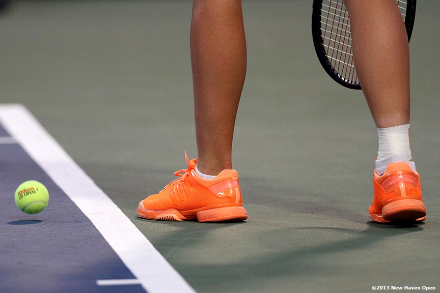 """The shoes of Caroline Wozniacki are shown as she prepares to serve during her semi-final match against Simona Halep on Day 8 of the New Haven Open at Yale University in New Haven, Connecticut Friday, August 20, 2013."""