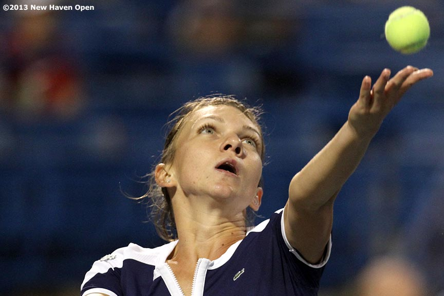 """""""Simona Halep tosses the ball a she serves during her semi-final match against Caroline Wozniacki on Day 8 of the New Haven Open at Yale University in New Haven, Connecticut Friday, August 20, 2013."""""""