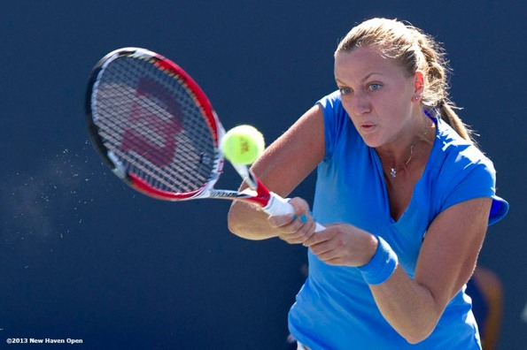 """Petra Kvitova hits a backhand against Simona Halep during the finals of the New Haven Open at Yale University in New Haven, Connecticut Saturday, August 24, 2013."""
