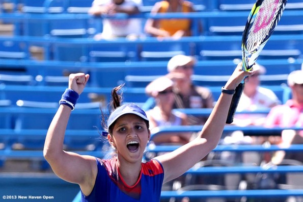 """Sania Mirza reacts after winning championship point with doubles partner Jie Zheng to win the New Haven Open at Yale University in New Haven, Connecticut Saturday, August 24, 2013."""