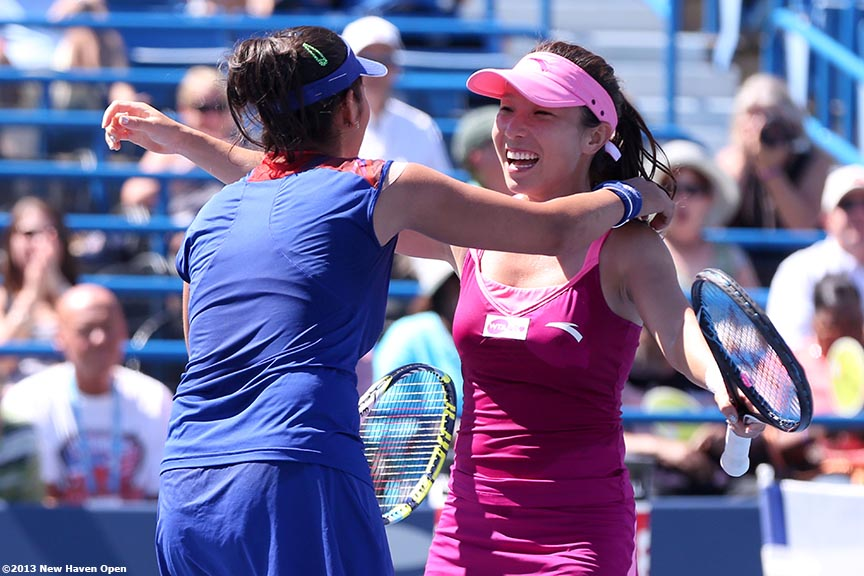 """Sania Mirza and Jie Zheng react after taking championship point to win the doubles title at the New Haven Open at Yale University in New Haven, Connecticut Saturday, August 24, 2013."""