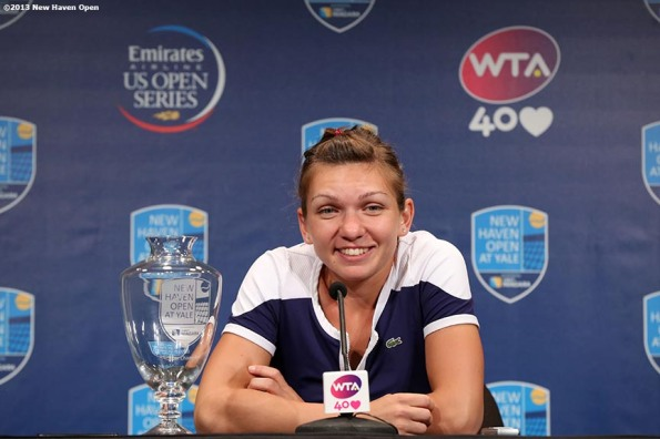 """Simona Halep speaks during a press conference after defeating Petra Kvitova to win the singles title at the New Haven Open at Yale University in New Haven, Connecticut Saturday, August 24, 2013."""