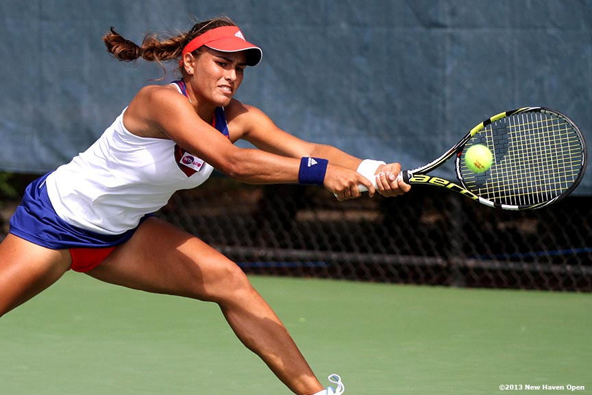 """Monica Puig returns a shot during her qualifying round match against Nadia Echeverria Alam on Day 1 of the New Haven Open at Yale University in New Haven, Connecticut Friday, August 16, 2013."""