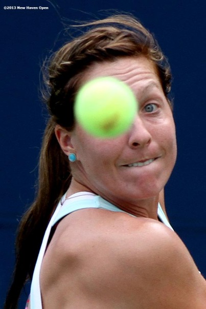"""Kelcy McKenna eyes a backhand return during a US Open National Playoff match on Day 1 of the New Haven Open at Yale University in New Haven, Connecticut Friday, August 16, 2013."""