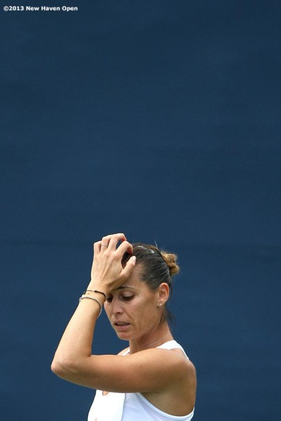 """Flavia Pennetta reacts after losing a point during a qualifying round match on Day 1 of the New Haven Open at Yale University in New Haven, Connecticut Friday, August 16, 2013."""