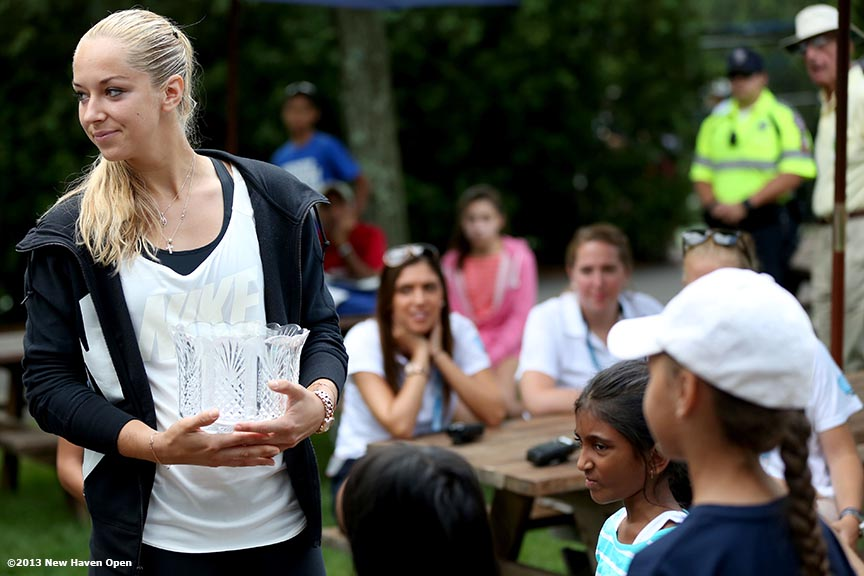 """2013 Wimbledon Ladies' Finalist Sabine Lisicki takes part in the main tournament draw ceremony on Day 1 of the New Haven Open at Yale University in New Haven, Connecticut Friday, August 16, 2013."""