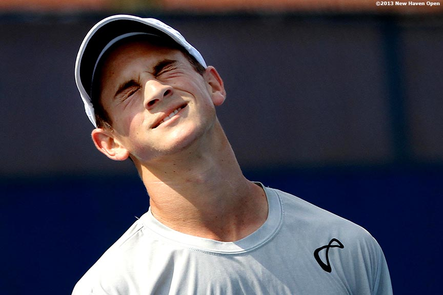 """Elliot Orkin reacts after losing a point during a US Open National Playoff match on Day 2 of the New Haven Open at Yale University in New Haven, Connecticut Saturday, August 17, 2013."""