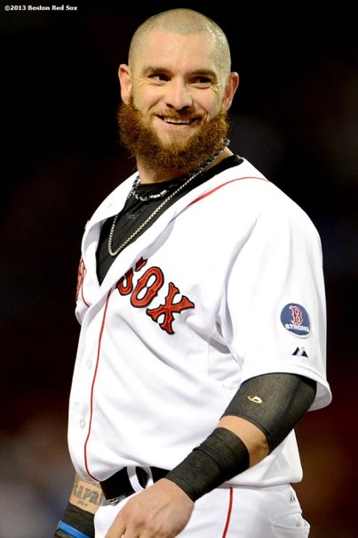 """Boston Red Sox outfielder Jonny Gomes smiles between innings during a game against the Detroit Tigers Tuesday, September 3, at Fenway Park in Boston, Massachusetts."""