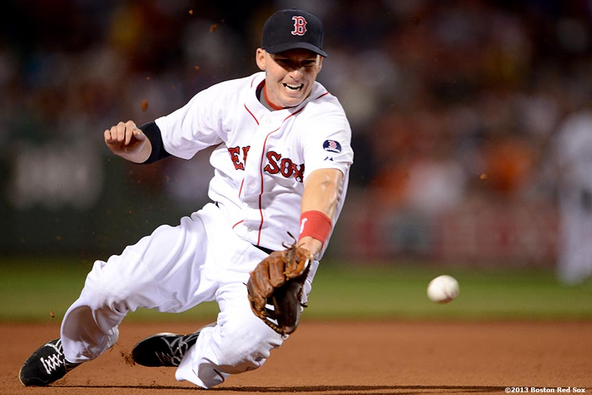 """Boston Red Sox shortstop Stephen Drew dives for a ground ball during the seventh inning of a game against the Detroit Tigers Tuesday, September 3, at Fenway Park in Boston, Massachusetts."""