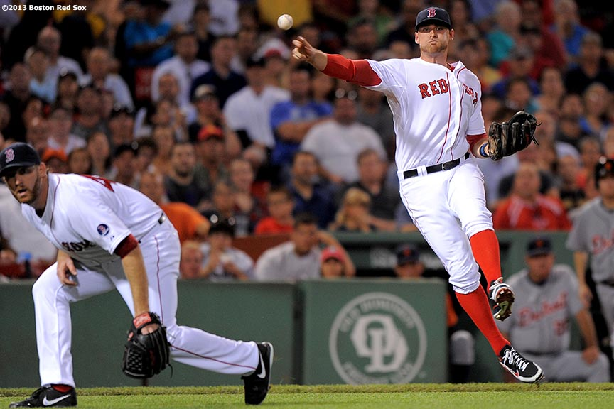 """Boston Red Sox third baseman Will Middlebrooks throws toward first base after fielding a ground ball during the third inning of a game against the Detroit Tigers Wednesday, September 4, 2013 at Fenway Park in Boston, Massachusetts."""