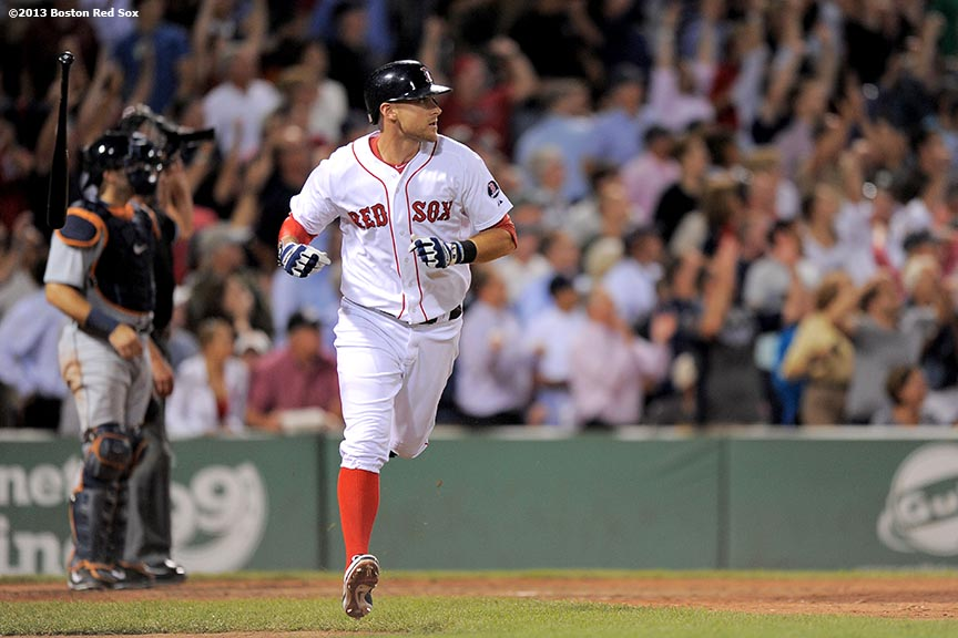 """Boston Red Sox third baseman Will Middlebrooks flips the bat after hitting a grand slam home run during the sixth inning of a game against the Detroit Tigers Wednesday, September 4, 2013 at Fenway Park in Boston, Massachusetts."""