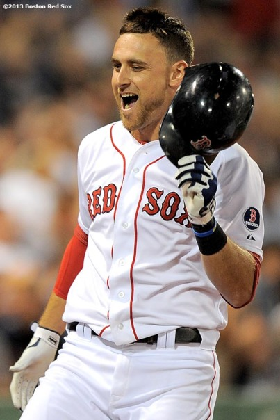 """Boston Red Sox third baseman Will Middlebrooks celebrates after hitting a grand slam home run during the sixth inning of a game against the Detroit Tigers Wednesday, September 4, 2013 at Fenway Park in Boston, Massachusetts."""