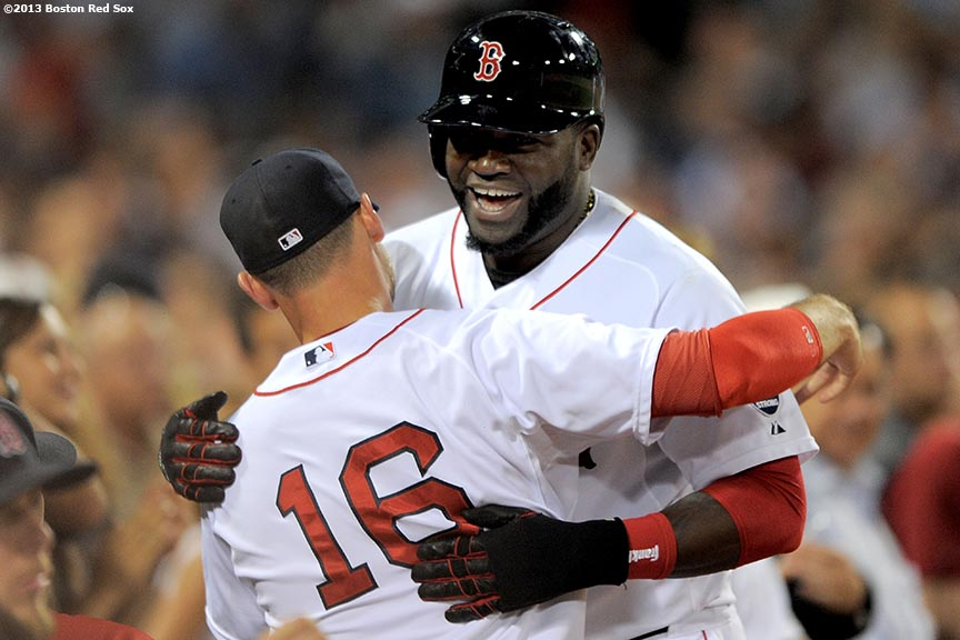 """Boston Red Sox designated hitter David Ortiz hugs third baseman Will Middlebrooks after hitting a double during the sixth inning of a game against the Detroit Tigers Wednesday, September 4, 2013 at Fenway Park in Boston, Massachusetts. The double was Ortiz' 2,000th hit of his Major League career."""