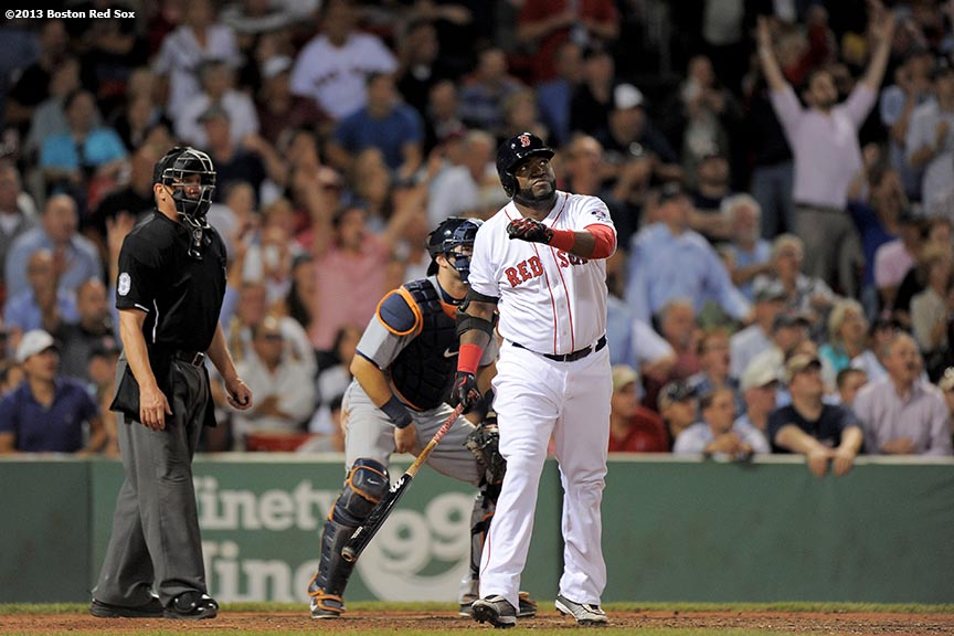 """Boston Red Sox designated hitter David Ortiz hits a two run home run, his second home run of the game, during the seventh inning of a game against the Detroit Tigers Wednesday, September 4, 2013 at Fenway Park in Boston, Massachusetts."""