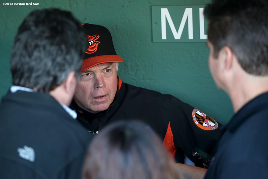 """Baltimore Orioles manager Buck Showalter is interviewed in the visitor's dugout before a game against the Boston Red Sox Tuesday, September 7, 2013 at Fenway Park in Boston, Massachusetts."""