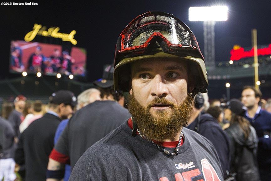 """Boston Red Sox outfielder Jonny Gomes celebrates in a helmet and goggles on the field after the Red Sox clinched the American League East title with a 6-3 win over the Toronto Blue Jays Friday, September 20, 2013 at Fenway Park."""