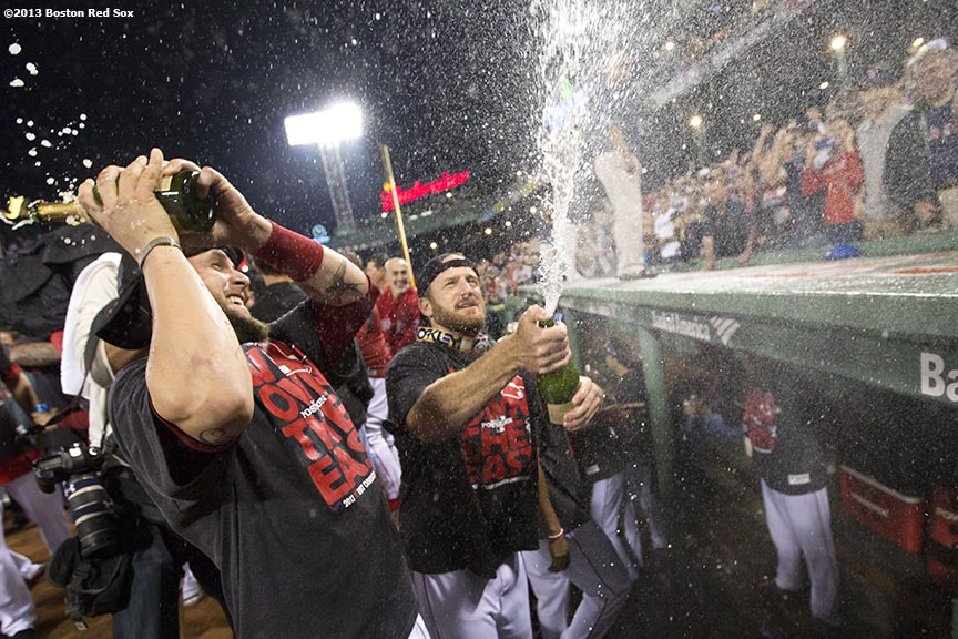 """Boston Red Sox pitchers Ryan Dempster and Brandon Snyder spray fans with champagne on the dugout during an on-field celebration after the Red Sox clinched the American League East title with a 6-3 win over the Toronto Blue Jays Friday, September 20, 2013 at Fenway Park."""