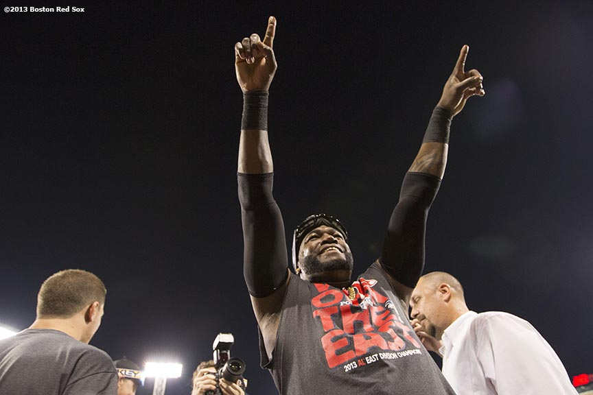 """Boston Red Sox designated hitter David Ortiz celebrates after the Red Sox clinched the American League East title with a 6-3 win over the Toronto Blue Jays Friday, September 20, 2013 at Fenway Park."""
