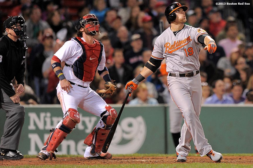 """Baltimore Orioles first baseman Chris Davis hits a home run during the sixth inning of a game against the Boston Red Sox Tuesday, September 17, 2013 at Fenway Park in Boston, Massachusetts. The home run was Davis' 51st of the season, breaking the Baltimore Orioles all-time franchise record for home runs in a single season, previously held by Brady Anderson."""