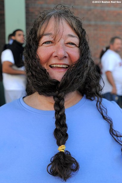 """A fan poses for a photograph as he lines up outside of Fenway Park in Boston, Massachusetts Wednesday, September 18, 2013 for Boston Red Sox Dollar Beard Night, a promotion which gave fans who attended the game with a beard or fake beard received a one dollar ticket."""