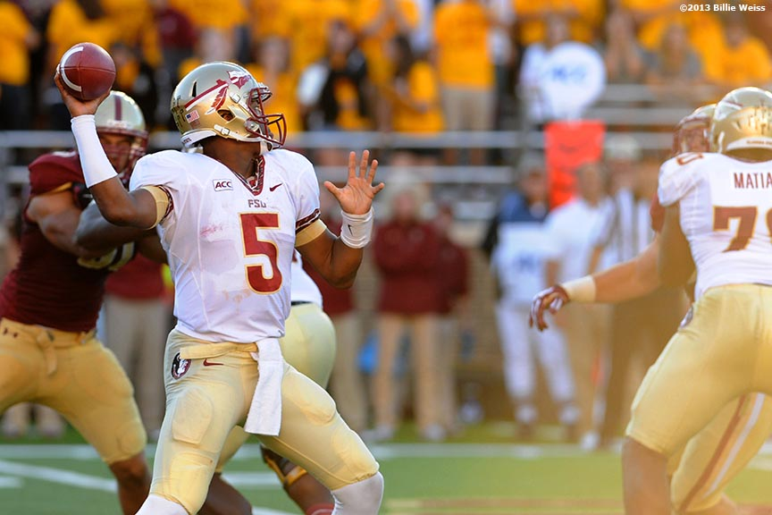 """""""Florida State Seminoles quarterback Jameis Winston throws a pass during the third quarter of a game against the Boston College Eagles at Alumni Stadium in Chestnut Hill, Massachusetts Saturday, September 28, 2013."""""""