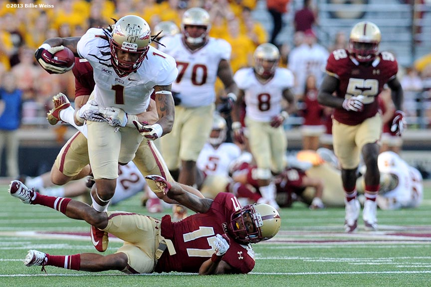 """Florida State Seminoles wide receiver Kelvin Benjamin leaps over defensive back Bryce Jones during the third quarter of a game against the Boston College Eagles at Alumni Stadium in Chestnut Hill, Massachusetts Saturday, September 28, 2013."""