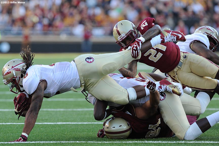 """Florida State Seminoles runningback Devonta Freeman is tackled by Manuel Asprilla during the third quarter of a game against the Boston College Eagles at Alumni Stadium in Chestnut Hill, Massachusetts Saturday, September 28, 2013."""