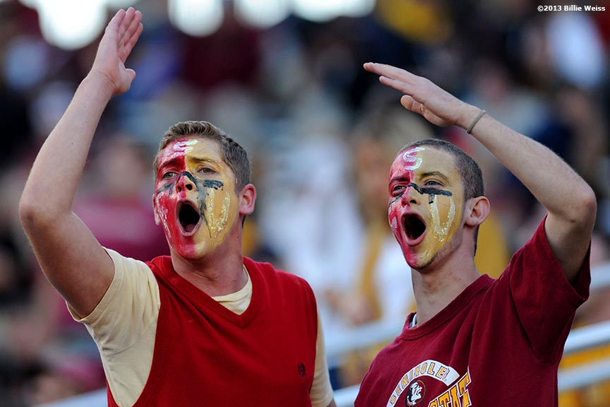 """Florida State fans lead a cheer during a game between the Florida State Seminoles and the Boston College Eagles at Alumni Stadium in Chestnut Hill, Massachusetts Saturday, September 28, 2013."""