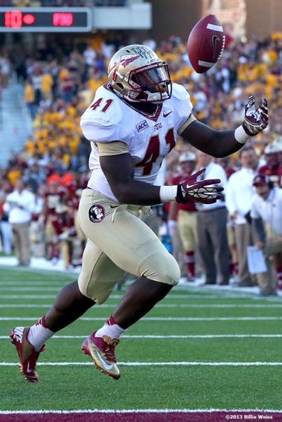 """Florida State Seminoles fullback Chad Abrams secures the ball as he scores a touchdown during the third quarter of a game against the Boston College Eagles at Alumni Stadium in Chestnut Hill, Massachusetts Saturday, September 28, 2013."""