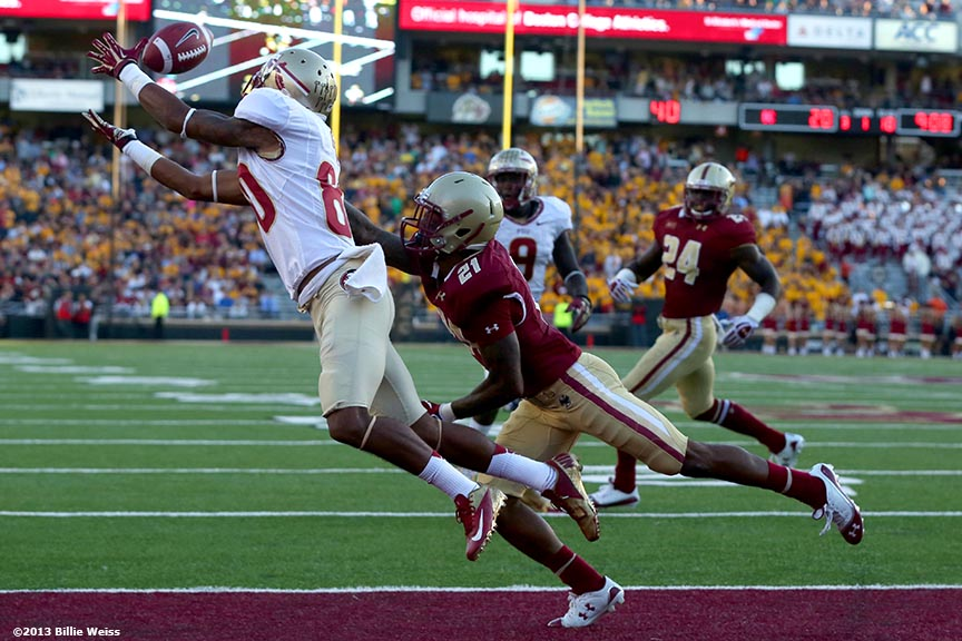 """Florida State Seminoles wide receiver Rashad Greene dives as he catches a pass and scores a touchdown during the third quarter of a game against the Boston College Eagles at Alumni Stadium in Chestnut Hill, Massachusetts Saturday, September 28, 2013."""