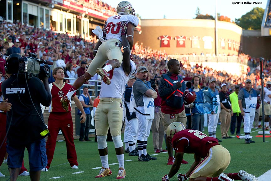 """Florida State Seminoles wide receiver Rashad Greene celebrates after scoring a touchdown during the third quarter of a game against the Boston College Eagles at Alumni Stadium in Chestnut Hill, Massachusetts Saturday, September 28, 2013."""