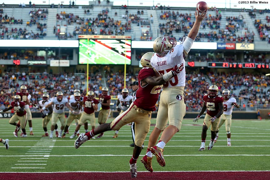 """Florida State Seminoles tight end Nick O'Leary attempts to catch a pass over linebacker Josh Keyes during the fourth quarter of a game against the Boston College Eagles at Alumni Stadium in Chestnut Hill, Massachusetts Saturday, September 28, 2013."""