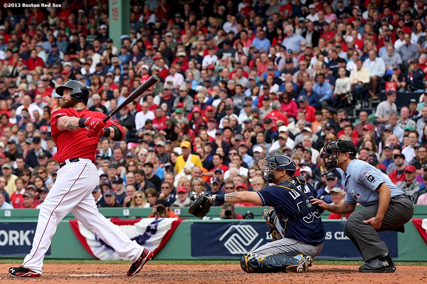 """Boston Red Sox right fielder Jonny Gomes hits an RBI double during the fourth inning of Game One of the American League Division Series against the Tampa Bay Rays Friday, October 4, 2013 at Fenway Park in Boston, Massachusetts."""