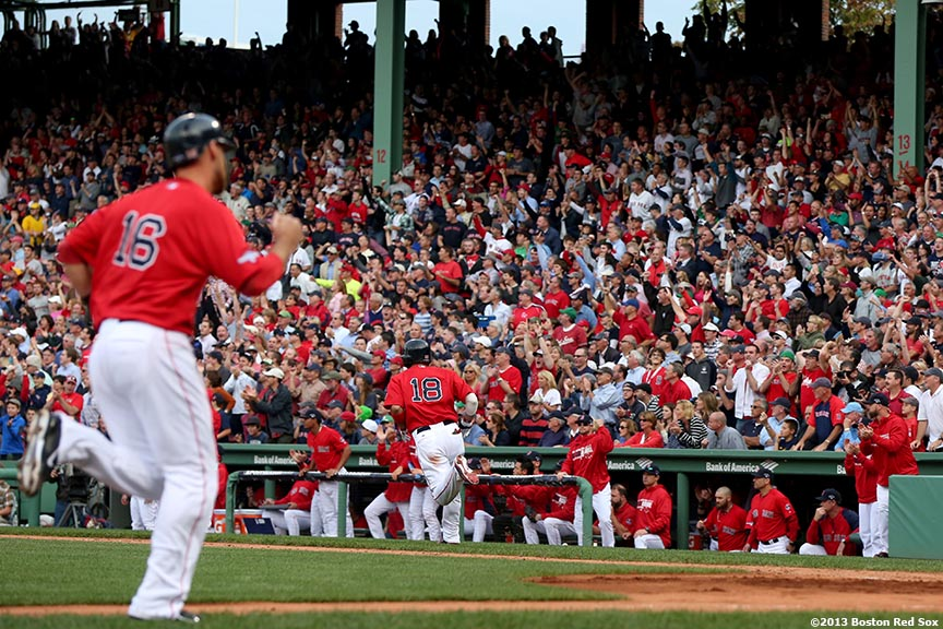 """""""Boston Red Sox third baseman Will Middlebrooks scores as right fielder Shane Victorino runs to first base after hitting an RBI single during the fourth inning of Game One of the American League Division Series against the Tampa Bay Rays Friday, October 4, 2013 at Fenway Park in Boston, Massachusetts."""""""