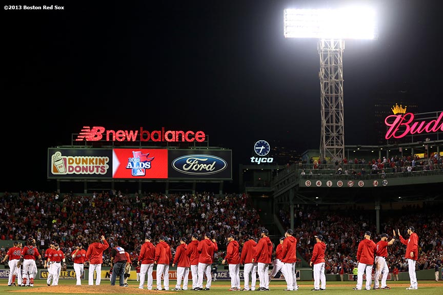 """Boston Red Sox players line up after defeating the Tampa Bay Rays in  Game One of the American League Division Series against the Tampa Bay Rays Friday, October 4, 2013 at Fenway Park in Boston, Massachusetts."""