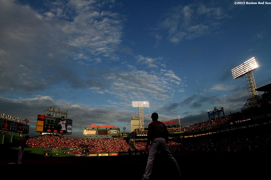 """Boston Red Sox third base coach Brian Butterfield gives signs during the sixth inning of Game One of the American League Division Series against the Tampa Bay Rays Friday, October 4, 2013 at Fenway Park in Boston, Massachusetts."""