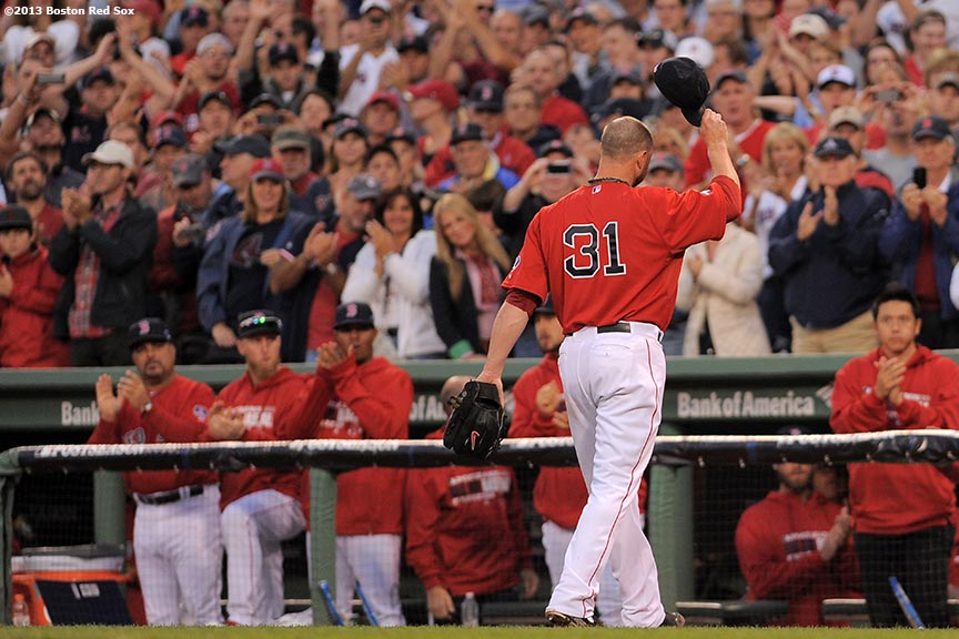 """Boston Red Sox pitcher Jon Lester tips his cap as he walks to the dugout during the eighth inning of Game One of the American League Division Series against the Tampa Bay Rays Friday, October 4, 2013 at Fenway Park in Boston, Massachusetts."""