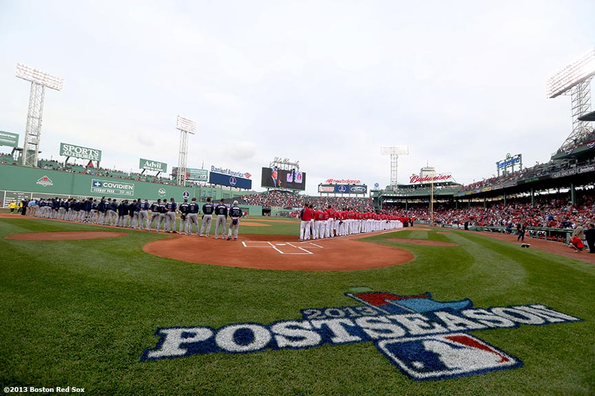 """Players line up in the infield during a pre-game ceremony before the first game of the American League Division Series between the Boston Red Sox and the Tampa Bay Rays Friday, October 4, 2013 at Fenway Park in Boston, Massachusetts."""