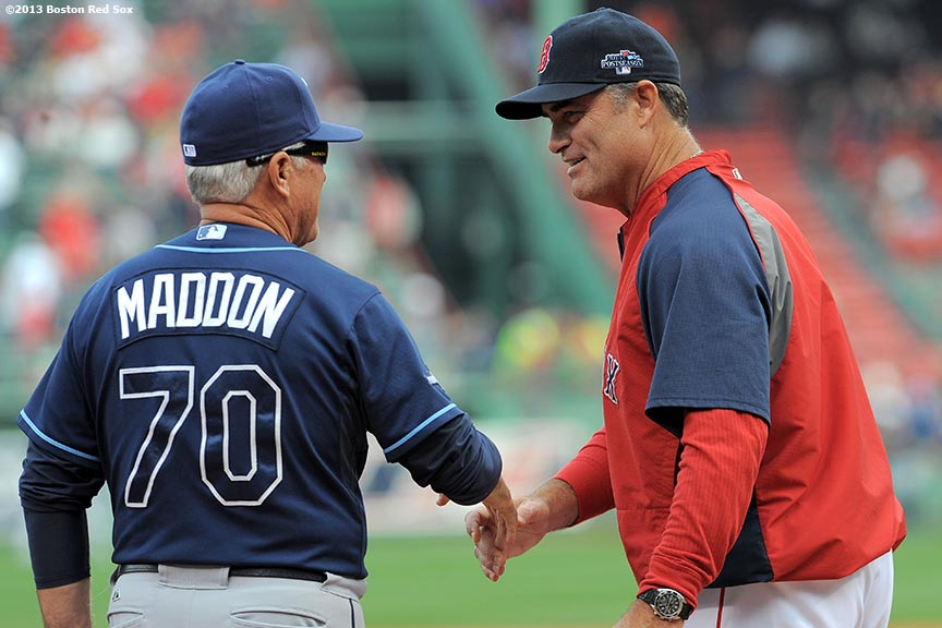 """Boston Red Sox manager John Farrell shakes Tampa Bay Rays manager Joe Maddon's hand during a pre-game ceremony before the first game of the American League Division Series Friday, October 4, 2013 at Fenway Park in Boston, Massachusetts."""