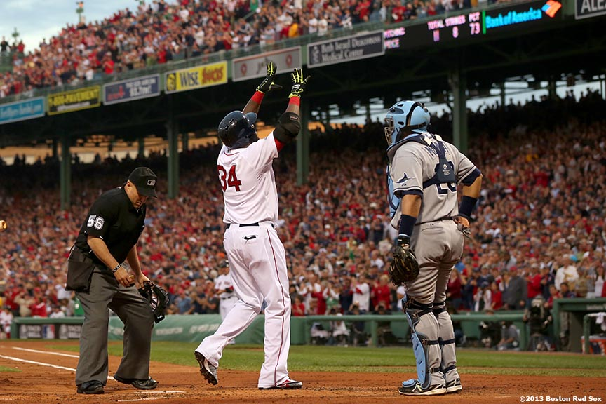"""Boston Red Sox designated hitter David Ortiz celebrates after hitting a home run during the first inning of game two of the American League Division Series against the Tampa Bay Rays Saturday, October 5, 2013 at Fenway Park in Boston, Massachusetts."""