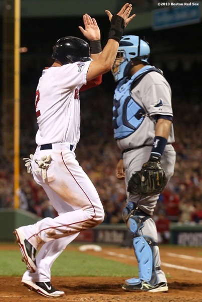 """Boston Red Sox center fielder Jacoby Ellsbury celebrates as he scores on an RBI double by Dustin Pedroia during the fifth inning of game two of the American League Division Series against the Tampa Bay Rays Saturday, October 5, 2013 at Fenway Park in Boston, Massachusetts."""